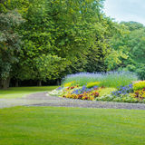 Summer park with flowerbeds Royalty Free Stock Image