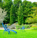 Summer park with lawn and recliner Stock Photo