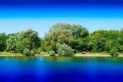 Summer park pond long exposure landscape background. Horizontal spacedrone808 orientation vivid vibrant bright color rich composition design concept element royalty free stock photography