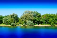 Summer park pond long exposure landscape background. Horizontal spacedrone808 orientation vivid vibrant bright color rich composition design concept element royalty free stock photo