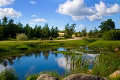 Summer park in Ventspils. Beautiful nature park on a summer day in city of Ventspils, Latvia. This is a clean and green park with a small lake inside of it royalty free stock photos