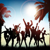 Summer party background. Silhouettes of people dancing on a tropical background Stock Image