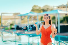 Summer Party Girl Blowing Soap Bubbles by the Pool Stock Photography