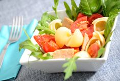 Summer  pasta. Pasta with  tomatoes rocket salad tuna and tomatoes Stock Photos