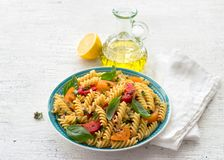 Summer pasta with tomatoes, herbs and olive oil stock photos