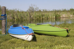 Summer Pastime. Two kayaks are ready to go out onto the waters for fun and recreation Stock Photos