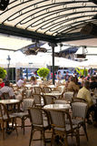 Summer patio of Cafe de Pari with wicker furniture Royalty Free Stock Photo