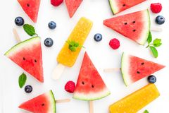 Summer patterm-  Watermelon slice  popsicle  and berries  on whi Royalty Free Stock Image