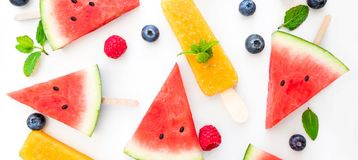 Summer patterm-  Watermelon slice  popsicle  and berries  on whi Stock Photos
