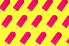 Summer pattern of pink popsicles on a yellow background Stock Image