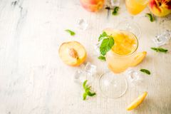 Summer peach Bellini cocktail royalty free stock photos