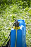 Pest control sprayer. Summer pest sprayer on grass ready for use royalty free stock photo