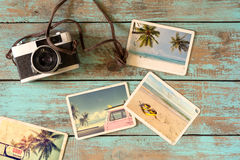 Summer photo album. Of journey in summer surfing beach trip on wood table. instant photo of vintage film camera - vintage and retro style stock photo