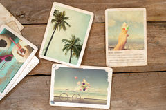 Summer photo album on wood table. Royalty Free Stock Photos