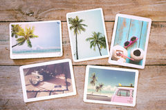 Summer photo album on wood table. Photography from beach vacation - vintage postcards and retro styles stock photography