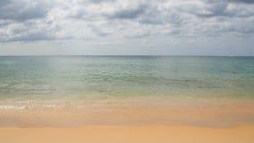 Summer photo of beach sea wave sand sky and clouds at tropical sea. Kata beach, Phuket Island, Thailand.  Stock Photo