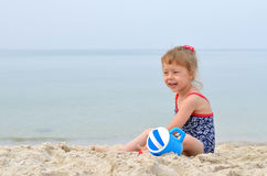 Summer Photo - charming girl playing on a sandy beach, space for Stock Photos