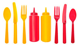 Summer Picnic. Concept with Bottles of Ketchup and Mustard.  Isolated on White with a Clipping Path Royalty Free Stock Photo