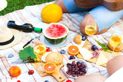 Summer Picnic Basket on the Green Grass. Food and drink concept. Stock Photography