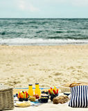 Summer picnic on the beach. Serving picnic utensils blue with ve Royalty Free Stock Images