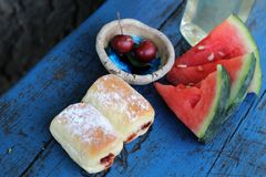 Summer picnic. On blue wooden bench Stock Photo