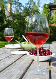 Summer picnic with cherries and wine glass. Summer picnic table with cherries, salad and wine Stock Photography