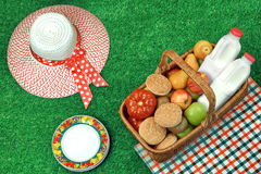 Summer Picnic Concept With Straw Hat And Food Basket Royalty Free Stock Image