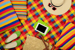 Summer picnic. Electronic book, hat and bag on the picnic mat. Stock Photography