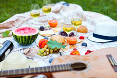 Summer Picnic on the Green Grass. Food and drink concept. Stock Photos