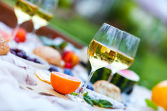 Summer Picnic on the Green Grass. Food and drink concept. Royalty Free Stock Photo