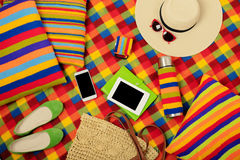 Summer picnic. Mobile phone, electronic book, hat and bag on the Stock Images