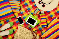 Summer picnic. Mobile phone, electronic book, hat and bag on the Stock Photo