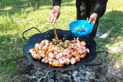 Summer picnic. Preparation of delicious sausages stock image