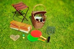 Summer Picnic. Scene in backyard on lawn. Tilt-shift effect in background Stock Photography