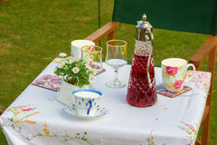 Summer picnic table set with cups and saucers Stock Photo