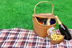 Summer Picnic With Wine On The Lawn Concept. Summer Picnic With Champagne Wine On The Lawn Close-up Concept Stock Photo
