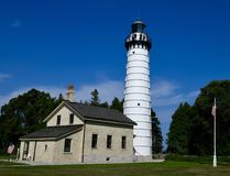Cana Island Lighthouse. This is a Summer picture of the historic Cana Island Lighthouse on Lake Michigan in Door County. The 89 foot tall cylindrical tower with stock image