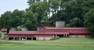 Midway Barn. This is a Summer picture of the iconic Midway Barn on the Taliesin Estate located in Spring, Green, Wisconsin in Sauk County. This stone and wood stock photo