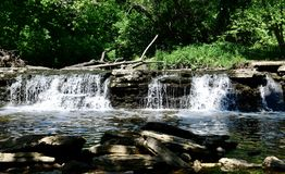 Waterfall at Waterfall Glen . This is a Summer picture of the iconic Waterfall on Saw Mill Creek located in Waterfall Glen Forest Preserve in Lamont, Illinois royalty free stock image