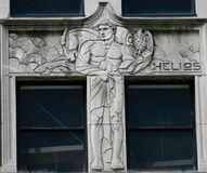 Helios. This is a Summer picture of public art titled: Helios, located on a building on Michigan Avenue in Chicago, Illinois in Cook County. This bas-relief of royalty free stock photo