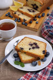 Summer pie  blueberry. Sliced summer cake with blueberry  with a cup of tea on the table Royalty Free Stock Photo