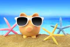 Summer piggy bank with sunglasses royalty free stock photography