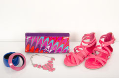 Summer pink sandals with bag and jewellery. Royalty Free Stock Images