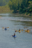 Summer is play. Teens kayaking on river stock images