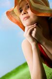 Summer pleasure. Portrait of happy woman in hat enjoying hot summer day Stock Photography