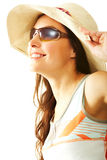 Summer pleasure. Portrait of happy girl in hat looking through sunglasses Stock Image