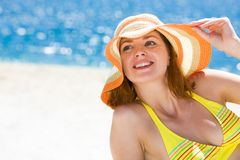 Summer pleasure. Portrait of happy woman in hat enjoying hot summer day on the beach Royalty Free Stock Image