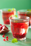 Summer pomegranate drink with melissa Royalty Free Stock Photo