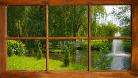 Summer pond with ducks, seen through a window. Stock Photos