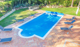 Summer pool in the courtyard near the house. Royalty Free Stock Photography